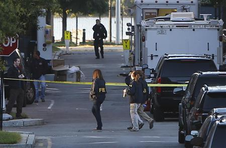 Investigators continue to work the scene at the Navy Yard two days after a gunman killed 12 people before police shot him dead, in Washington, September 18, 2013. REUTERS/Jonathan Ernst