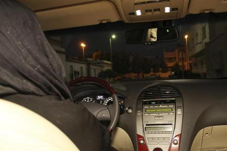 A Saudi woman poses in this picture to illustrate driving a car in Jeddah June 17, 2011. REUTERS/Susan Baaghil/Files