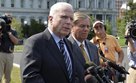 U.S. Senator John McCain (R-AZ), (L), makes remarks to the media as U.S. Senator Lindsey Graham (R-SC) listens, after meeting with U.S. President Barack Obama at the White House, on possible military action against Syria, in Washington September 2, 2013. REUTERS/Mike Theiler