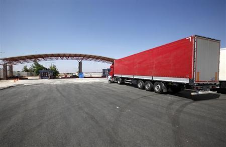 A truck is parked at the entrance of Oncupinar border gate in Kilis, southeast Turkey, in this file photo taken July 25, 2012. REUTERS/Umit Bektas