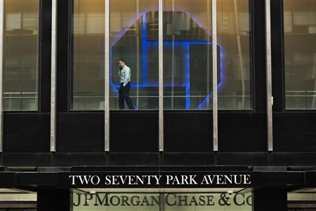 A man talks on his phone while pacing inside of the headquarters of JPMorgan Chase & Co bank in New York, March 15, 2013. REUTERS/Lucas Jackson