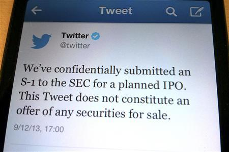 A tweet from Twitter Inc. announcing its initial public offering is shown in this photo illustration in Toronto, September 12, 2013. REUTERS/Hyungwon Kang