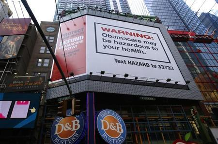 A billboard on West 42nd Street between 7th and 8th Avenues advertising the defunding of ''Obamacare'' the Affordable Care Act (ACA), paid for by the conservative Heritage Foundation, is pictured in New York September 12, 2013. REUTERS/Mike Segar