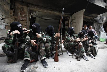 Female members of the ''Mother Aisha'' battalion sit together along a street in Aleppo's Salaheddine district, September 19, 2013. REUTERS/Loubna Mrie