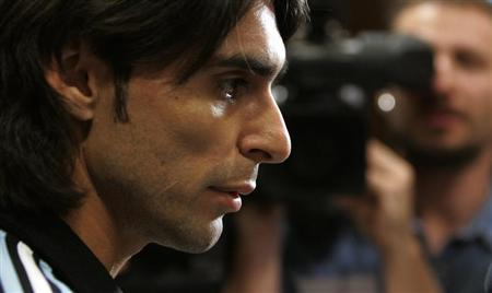 Argentina's national football team captain Roberto Ayala faces reporters at the end of a press conference in Basel in this file photograph taken June 1, 2007. REUTERS/Christian Hartmann