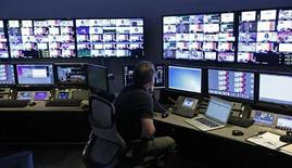"""A technician works in the """"Acquisition Room"""", which receives televison feeds from around the world, during an event to mark the opening of the new Univision and Fusion television networks newsroom in Doral, Florida August 28, 2013. REUTERS/Joe Skipper"""