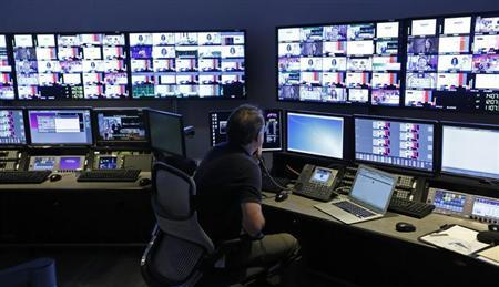 A technician works in the ''Acquisition Room'', which receives televison feeds from around the world, during an event to mark the opening of the new Univision and Fusion television networks newsroom in Doral, Florida August 28, 2013. REUTERS/Joe Skipper