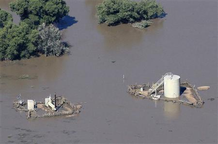 An oil well pad is surrounded by flood waters in Weld County, Colorado September 17, 2013. REUTERS/Rick Wilking