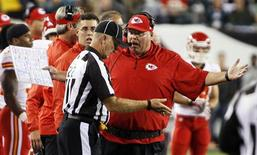 Kansas City Chiefs head coach Andy Reid (R) argues a call with an official during their NFL football game with the Philadelphia Eagles in Philadelphia, Pennsylvania, September 19, 2013. Kansas City won 26-16. REUTERS/Tom Mihalek