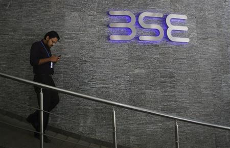 An employee walks out of the Bombay Stock Exchange (BSE) building in Mumbai August 22, 2013. REUTERS/Danish Siddiqui/Files