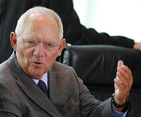 German Finance Minister Wolfgang Schaeuble gestures during a cabinet meeting at the Chancellery in Berlin August 28, 2013. REUTERS/Fabrizio Bensch (GERMANY - Tags: POLITICS BUSINESS) - RTX12YNP