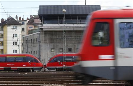 Trains drive past the signal tower of the Deutsche Bahn at the main train station in Mainz August 13, 2013. REUTERS/Ralph Orlowski