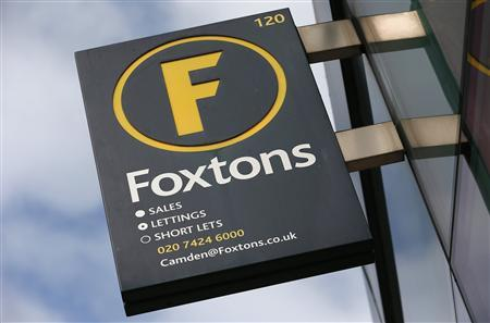 A Foxtons estate agent sign is seen outside a branch in north London September 3, 2013. REUTERS/Suzanne Plunkett