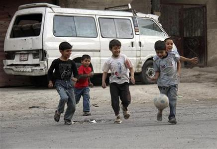 Boys play with a football along a street in Yalda in Damascus province September 19, 2013. REUTERS-Ward Al-Keswani