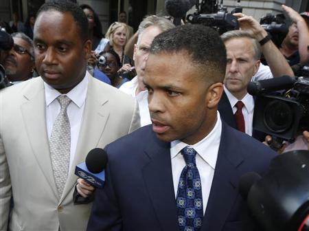 Jesse Jackson Jr. leaves his sentencing hearing in Washington, August 14, 2013. REUTERS/Jason Reed