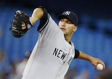 New York Yankees Andy Pettitte pitches to the Toronto Blue Jays during the first inning of their MLB American League baseball game in Toronto, September 17, 2013. REUTERS/Mark Blinch