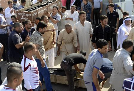 Mourners carry the coffin of a victim of a bomb attack during a funeral in Samarra September 20, 2013. REUTERS/Bakr al-Azzawi