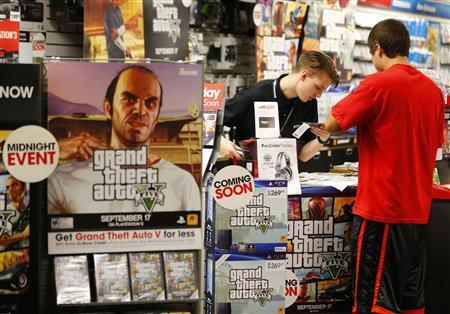 Game enthusiasts purchase the latest release of ''Grand Theft Auto Five'' after the game went on sale at the Game Stop store in Encinitas, California September 17, 2013. REUTERS/Mike Blake