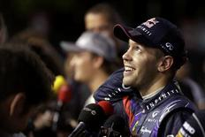 Red Bull Formula One driver Sebastian Vettel of Germany reacts during an interview after the qualifying session of the Singapore F1 Grand Prix at the Marina Bay street circuit in Singapore September 21, 2013. REUTERS/Pablo Sanchez