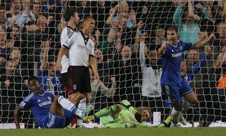 Chelsea's John Obi Mikel (L) celebrates scoring his goal against Fulham with Branislav Ivanovic (R) during their English Premier League soccer match at Stamford Bridge in London September 21, 2013. REUTERS/Eddie Keogh