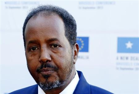 Somali's President Hassan Sheikh Mohamud talks to reporters ahead of a conference called ''New Deal in Somalia'' in Brussels September 16, 2013. REUTERS/Yves Herman