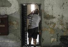 A visitor photographs a jail cell during a tour of the Missouri State Penitentiary in Jefferson City September 12, 2013 . REUTERS/Sarah Conard