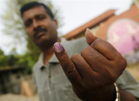 A Tamil man shows his ink-stained finger after casting his vote at a polling station during the first provincial polls in 25 years in Jaffna, a former war zone in northern Sri Lanka, about 400 kilometres (249 miles) north of Colombo September 21, 2013. REUTERS/Dinuka Liyanawatte