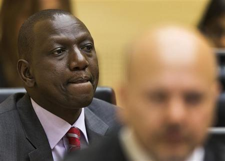 Kenya's Deputy President William Ruto reacts in the courtroom before his trial at the International Criminal Court (ICC) in The Hague September 10, 2013. REUTERS/Michael Kooren