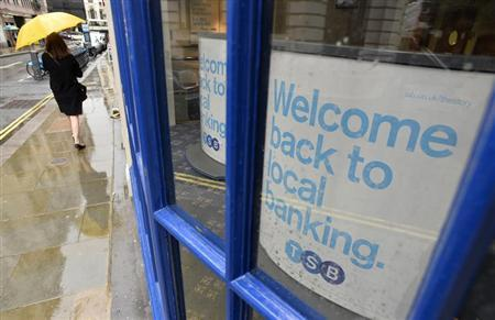 A pedestrian walks past a branch of the TSB bank in central London September 9, 2013. REUTERS/Toby Melville