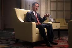 Wang Jianlin, chairman of Chinese property developer Dalian Wanda Group, answers a question during a Reuters interview in Qingdao, Shandong province, September 22, 2013. REUTERS/Jason Lee
