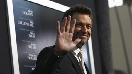 Cast member Hugh Jackman waves at the premiere of his film ''Prisoners'' at the Academy of Motion Picture Arts and Sciences in Beverly Hills, California September 12, 2013. REUTERS/Mario Anzuoni