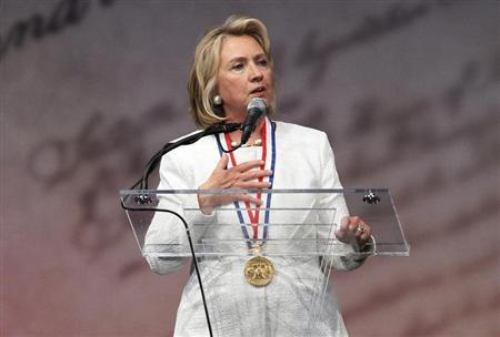 Former U.S. Secretary of State Hillary Clinton speaks at the Liberty Medal ceremony after receiving the award, at the National Constitution Center in Philadelphia, Pennsylvania, Septmeber 10, 2013. REUTERS/Tom Mihalek