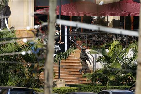 A Kenyan soldier walks out of the main gate of Westgate Shopping Centre in Nairobi September 22, 2013. REUTERS/Goran Tomasevic