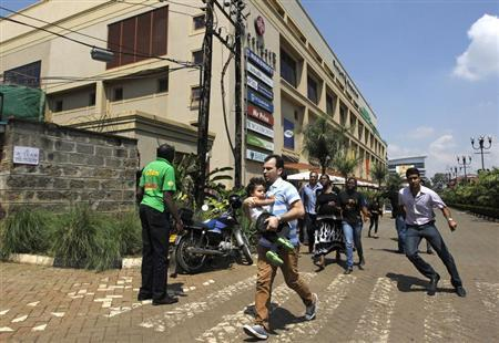 Customers run following a shootout between unidentified armed men and the police at the Westgate shopping mall in Nairobi September 21, 2013. REUTERS/Thomas Mukoya