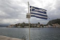 A Greek flag flutters at the port of the Greek southeastern island of Kastelorizo April 15, 2013. Picture taken April 15, 2013. REUTERS/Yorgos Karahalis