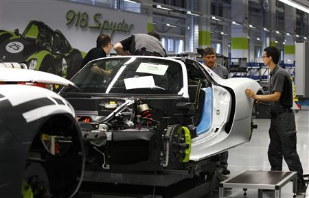 Workers assemble a new Porsche 918-Spyder sports car at the production line of the German car manufacturer's plant in Stuttgart-Zuffenhausen July 2, 2013. REUTERS/Michaela Rehle