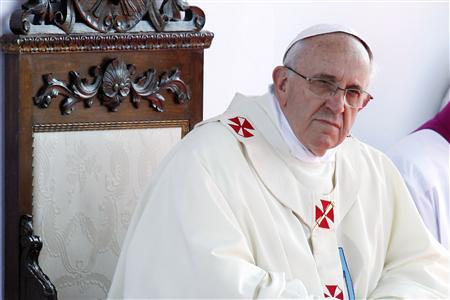 Pope Francis looks on as he leads a mass outside the Shrine of Our Lady of Bonaria in Cagliari September 22, 2013. REUTERS/Giampiero Sposito (ITALY - Tags: RELIGION) - RTX13UHC