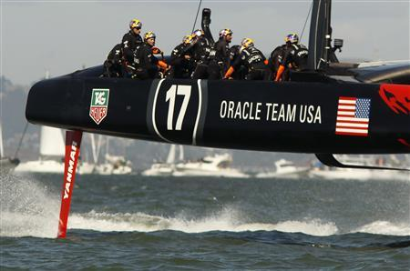 Oracle Team USA heads to the finish line to defeat Emirates Team New Zealand during Race 15 of the 34th America's Cup yacht sailing race in San Francisco, California September 22, 2013. REUTERS/Robert Galbraith