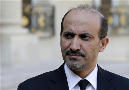 Ahmad Jarba, head of the opposition Syrian National Coalition, speaks to journalists in the courtyard of the Elysee Palace after a meeting with French President Francois Hollande in Paris, August 29, 2013. REUTERS/Jacky Naegelen