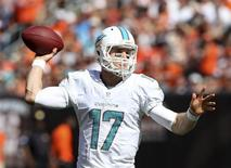 Miami Dolphins quarterback Ryan Tannehill throws a pass during the fourth quarter of their NFL football game against the Cleveland Browns in Cleveland, Ohio September 8, 2013. REUTERS/Aaron Josefczyk