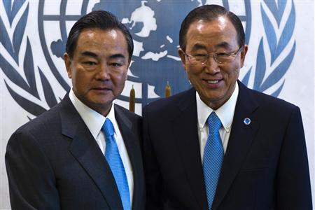 China's Foreign Minister Wang Yi (L) shakes hands as he meets with United Nations General Secretary Ban-Ki Moon at the U.N. headquarters in New York, September 22, 2013. REUTERS/Eduardo Munoz