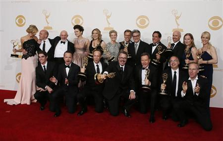 The cast and crew from AMC's series 'Breaking Bad' poses backstage with their awards for Outstanding Drama Series at the 65th Primetime Emmy Awards in Los Angeles September 22, 2013. REUTERS/Lucy Nicholson