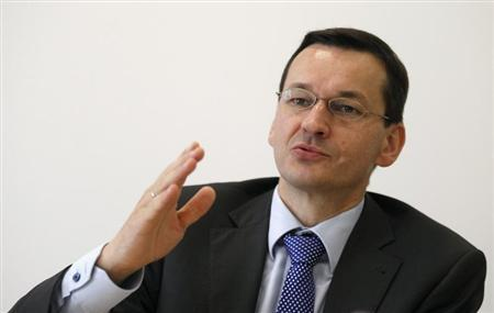 Mateusz Morawiecki, CEO of Poland's Bank Zachodni WBK, gestures during an interview with Reuters at the Reuters Eastern Europe Investment Summit, in Warsaw September 23, 2013. BZ WBK, the Polish unit of Spain's Santander, will see growth in its net profit this year of more than 6 percent, exceeding analysts forecasts, Morawiecki said on Monday. REUTERS/Kacper Pempel