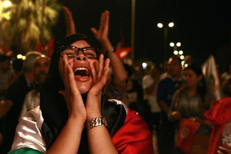 A protester shouts slogans during a demonstration to call for the departure of the Islamist-led ruling coalition, outside the Constituent Assembly headquarters in Tunis September 7, 2013. REUTERS/ Anis Mili