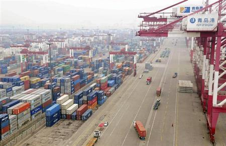 Trucks are used to transport containers at a port in Qingdao, Shandong province July 10, 2013. REUTERS/China Daily