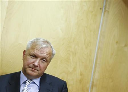 European Commissioner for Economy and Monetary Affairs Olli Rehn listens to a journalist during an interview in Alpbach August 29, 2013. REUTERS/Dominic Ebenbichler