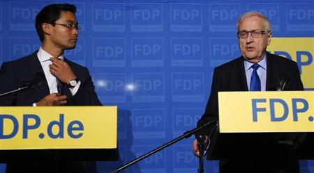 German Economy Minister and leader of the liberal Free Democratic Party (FDP) Philipp Roesler (L) and the party's top candidate Rainer Bruederle attend a news conference after a presidium meeting in Berlin September 23, 2013, a day after the German general election (Bundestagswahl). REUTERS/Tobias Schwarz