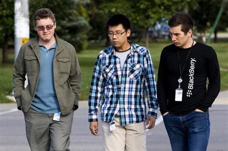 Men wearing employee tags walk on the sidewalk in front of the BlackBerry campus in Waterloo September 23, 2013. REUTERS/Mark Blinch