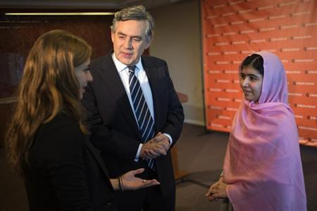 UN Special Envoy for Global Education and former Prime Minister Gordon Brown (C) stands between Malala Yousafzai (R), the Pakistani girl who was shot on a school bus by the Taliban last October for campaigning on the education of girls, and Farah Haddad, a Syrian student living in the United States, at a news conference convened by 'A World at School' in New York September 23, 2013. REUTERS/Adrees Latif