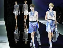 Models present creations from the Giorgio Armani Spring/Summer 2014 collection during Milan Fashion Week September 23, 2013. REUTERS/Alessandro Garofalo